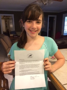 Megan with her letter of congratulations.