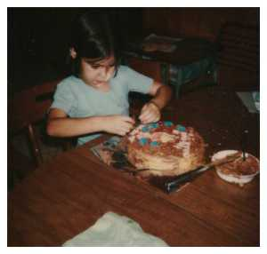 Ginger decorates a cake at my 8th birthday party. It was a favorite party with all my friends as my mother gave each girl in attendance a cake to decorate.
